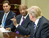 "Kenneth C. Frazier, Chairman and CEO of Merck & Co makes remarks to United States President Donald Trump as he meets with representatives from PhRMA, the Pharmaceutical Research and Manufacturers of America in the in the Oval Office Roosevelt Room of the White House in Washington, DC on Tuesday, January 31, 2017.  According to its website PhRMA ""represents the country's leading biopharmaceutical researchers and biotechnology companies.""   At left is Stephen Ubl, President and CEO, PhARMA.<br /> Credit: Ron Sachs / Pool via CNP"