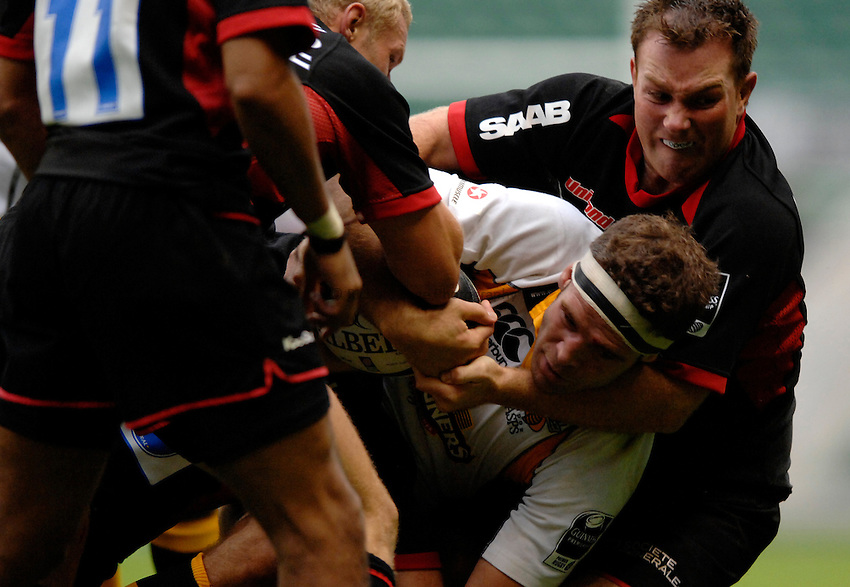 Photo: Richard Lane..Saracens v London Wasps. Guinness Premiership. 02/09/2006. .Wasps' Joe Worsley is tackled by Glen Jackson.