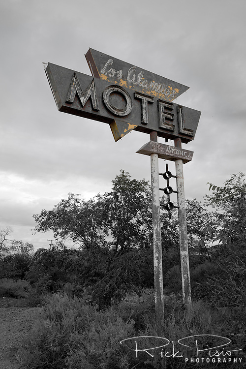 The neon sign for Los Alamitos Motel in Grants, New Mexico, no longer glows brightly to entice the tired traveler.
