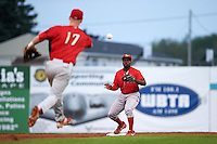 Williamsport Crosscutters second baseman Josh Tobias (33) waits for a throw from Dylan Bosheers (17) during a game against the Batavia Muckdogs on August 29, 2015 at Dwyer Stadium in Batavia, New York.  Williamsport defeated Batavia 7-3.  (Mike Janes/Four Seam Images)