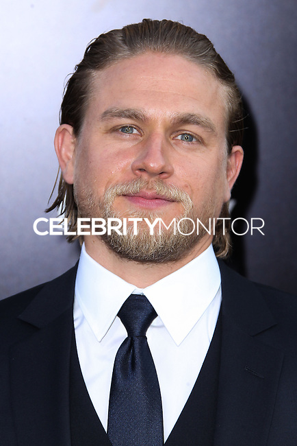 "[(FILE) Actor Charlie Hunnam has dropped out of the lead role of character Christian Grey in the ""Fifty Shades of Grey"" (2014) film adaptation. ""The filmmakers of 'Fifty Shades of Grey' and Charlie Hunnam have agreed to find another male lead given Hunnam's immersive TV schedule which is not allowing him time to adequately prepare for the role of Christian Grey,"" Universal Pictures said in a statement, obtained by The Hollywood Reporter.] HOLLYWOOD, CA - JULY 09: Actor Charlie Hunnam attends the premiere of Warner Bros. Pictures and Legendary Pictures' 'Pacific Rim' at the Dolby Theatre on July 9, 2013 in Hollywood, California. (Photo by Xavier Collin/Celebrity Monitor)"