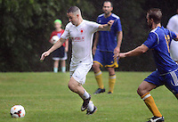 Region I Champion Phoenix Sports Club's Christopher Davis (4) drives towards the net as Region II Champion Carpathia Kickers of Michigan's Giovanni Pisacreta (16) defends in the second half of a semi final in the U.S. Adult Soccer Association over-30 men's championship final four during a rain storm Saturday July 30, 2016 in Feasterville, Pennsylvania. (Photo by William Thomas Cain)