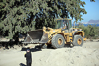 Pictured: A Caterpilar 950 digger, very similar to the one driven by Konstantinos Barkas on the day of Ben Needham's disappearance, operates at the farmhouse site in Kos, Greece. Sunday 09 October 2016<br />