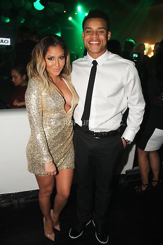 HOLLYWOOD, CA - JANUARY 24: Adrienne Bailon, Robert Ri'chard attends the OK! Magazine pre-Grammy party at Lure Nightclub on January 24, 2014 in Hollywood, California. Credit: Walik Goshorn/MediaPunch
