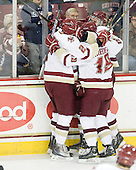 Brian Dumoulin (BC - 2), Chris Kreider (BC - 19) and Jimmy Hayes (BC - 10) celebrate Hayes' goal which tied the game at 1 midway through the first period. - The Boston College Eagles defeated the visiting University of Massachusetts-Lowell River Hawks 5-3 (EN) on Saturday, January 22, 2011, at Conte Forum in Chestnut Hill, Massachusetts.