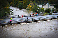 Flooding effected the villages of Aberdulais and Tonna in the Neath Valley after Storm Callum brought heavy rain and wind to the area causing the River Neath to reach bursting point. <br /> The River Neath, reaching the height of a road crossing which allows cars to travel between each village. Saturday 13 October 2018