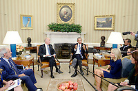 United States President Barack Obama with US Vice President Joe Biden and Dr. Jill Biden, second right, meet to discuss the release of the Cancer Moonshot Report in the Oval Office of the White House on October 17, 2016 in Washington, DC. <br /> Credit: Olivier Douliery / Pool via CNP /MediaPunch