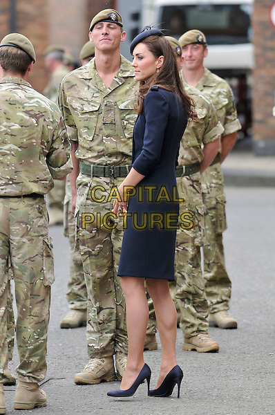 Catherine, Duchess of Cambridge Prince William, Duke of Cambridge and Catherine, Duchess of Cambridge present Afghanistan campaign medals to the 1st Battalion Irish Guards, Victoria Barracks, Windsor, Berkshire .England, UK, 25th June 2011..full length coat uniform military side   Kate Middleton princess black hat  gold brass buttons  royal shoes  soldiers army .CAP/CAS.©Bob Cass/Capital Pictures.