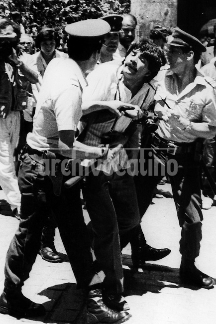 Photographer Juan Carlos Caceres is arrested by police during a protest against Pinoche dictatorship in 1986<br /> <br /> Forty years ago, on September 11, 1973, a military coup led by General Augusto Pinochet toppled the democratic socialist government of Chile. President Salvador Allende was killed during the  attack to seize  La Moneda presidential palace.  In the aftermath of the coup, a quarter of a million people were detained for their political beliefs, 3000 were killed or disappeared and many thousands were tortured.<br /> Some years later in 1981, while Pinochet ruled Chile with iron fist, a young photographer called Juan Carlos Caceres started to freelance in the streets of Santiago and the poblaciones or poor outskirts, showing the growing resistance against the dictatorship. For the next 10 years Caceres photographed every single protest and social movement fighting for the restoration of democracy. He knew that his camera was his only weapon, he knew that his fate was to register the daily violence and leave his images for the History.<br /> In this days Caceres is working to rescue and organize his collection of images in the project Imagenes de la Resistencia   . With support of some Chilean official institutions, thousands of negatives are digitalized and organized to set up the more complete visual heritage of this  violent period of Chile&acute;s history.