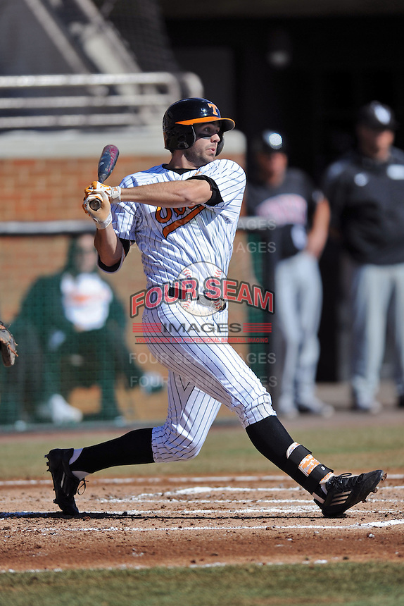Right fielder Scott Price #5 of the Tennessee Volunteers swings at a pitch during a game against the UNLV Runnin' Rebels at Lindsey Nelson Stadium on February 22, 2014 in Knoxville, Tennessee. The Volunteers defeated the Rebels 5-4. (Tony Farlow/Four Seam Images)