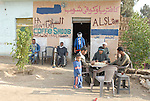 Local people at a cafe in a small village on the west bank near Luxor.The town of Luxor occupies the eastern part of a great city of antiquity which the ancient Egytians called Waset and the Greeks named Thebes.