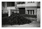 Bricks of coal, the fuel of East Germany, East Berlin, 18 November 1989. Photograph copyright Graham Harrison.
