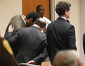 Defense attorney Peter Greenspun talks to convicted sniper John Allen Muhammad, left, after the jury reccommendation of death was read in courtroom 10 at the Virginia Beach Circuit Court in Virginia Beach, Virginia on Monday November 24, 2003. <br /> Credit: Davis Turner - Pool via CNP