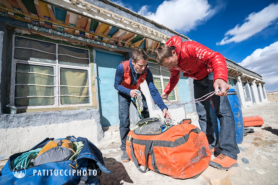 Ueli Steck and David Göttler packing for their climbing expedition to the 8000 meter peak Shishapangma, Tibet