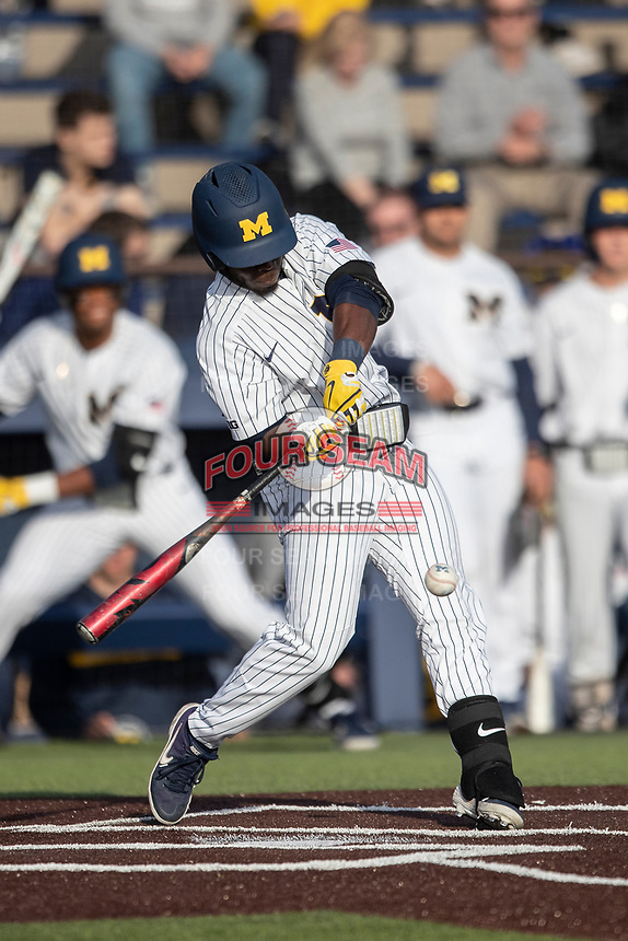 Michigan Wolverines second baseman Ako Thomas (4) swings the bat during the NCAA baseball game against the Eastern Michigan Eagles on May 8, 2019 at Ray Fisher Stadium in Ann Arbor, Michigan. Michigan defeated Eastern Michigan 10-1. (Andrew Woolley/Four Seam Images)