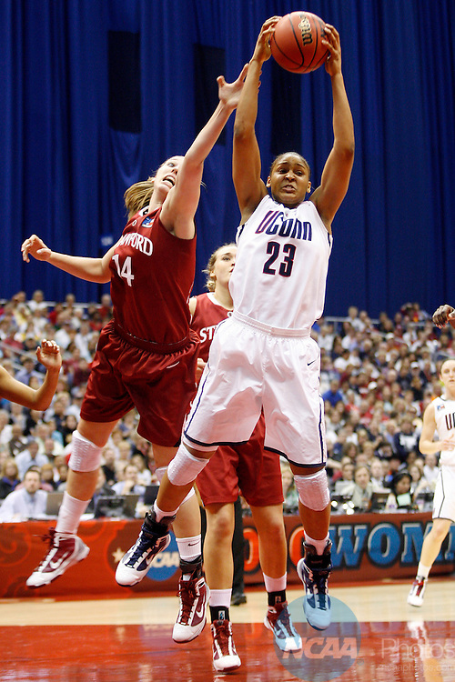 06 APR 2010:  Maya Moore (23) of the University of Connecticut and Kayla Pedersen (14) of Stanford University battle for a rebound during the Division I Women's Basketball Championship held at the Alamodome in San Antonio, TX.  Connecticut defeated Stanford 53-47 for the national title.  Jamie Schwaberow/NCAA Photos