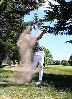 Tom Parker plays out of the trees during the New Zealand Amateur Golf Championship at Russley Golf Course, Christchurch, New Zealand. Sunday 5 November 2017. Photo: Simon Watts/www.bwmedia.co.nz