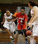 SIOUX FALLS MARCH 22:  Camille Dash #4 of Francis Marion dribbles past Kiki Robertson #23 of Alaska Anchorage during their quarterfinal game at the NCAA Women's Division II Elite 8 Tournament at the Sanford Pentagon in Sioux Falls, S.D.  (Photo by Dick Carlson/Inertia)