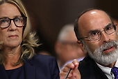 WASHINGTON, DC - SEPTEMBER 27:  Michael Bromwich (R) speaks on behalf of his client Christine Blasey Ford as she testifies before the Senate Judiciary Committee in the Dirksen Senate Office Building on Capitol Hill September 27, 2018 in Washington, DC. A professor at Palo Alto University and a research psychologist at the Stanford University School of Medicine, Ford has accused Supreme Court nominee Judge Brett Kavanaugh of sexually assaulting her during a party in 1982 when they were high school students in suburban Maryland. In prepared remarks, Ford said, ÒI donÕt have all the answers, and I donÕt remember as much as I would like to. But the details about that night that bring me here today are ones I will never forget. They have been seared into my memory and have haunted me episodically as an adult.Ó  (Photo by Win McNamee/Getty Images)