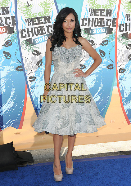NAYA RIVERA.Fox Teen Choice 2010 Awards held at the Universal Ampitheatre in Universal City, California, USA..August 8th, 2010    .full length grey gray blue print prom dress hand on hip beige shoes frills .CAP/RKE/DVS.©DVS/RockinExposures/Capital Pictures.