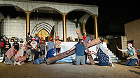 Jesus (J.P. Dean) bears his cross through the street Tuesday, May 19, 2020, during a rehearsal for the 2020 season at The Great Passion Play in Eureka Springs. The play will open their season Friday with adjustments for cast and audience members to stay within Arkansas Department of Health social distancing guidelines. Go to nwaonline.com/photos to see more photos.<br /> (NWA Democrat-Gazette/Ben Goff)