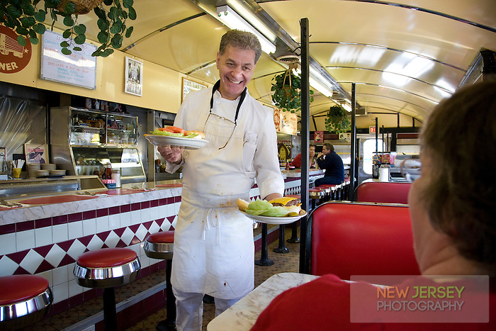 Chef of a Roadside Train Diner serving customers with a smile
