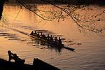Eight man crew rowing along Montlake Cut near the University of Washington sunrise overhead view Seattle Washington State USA