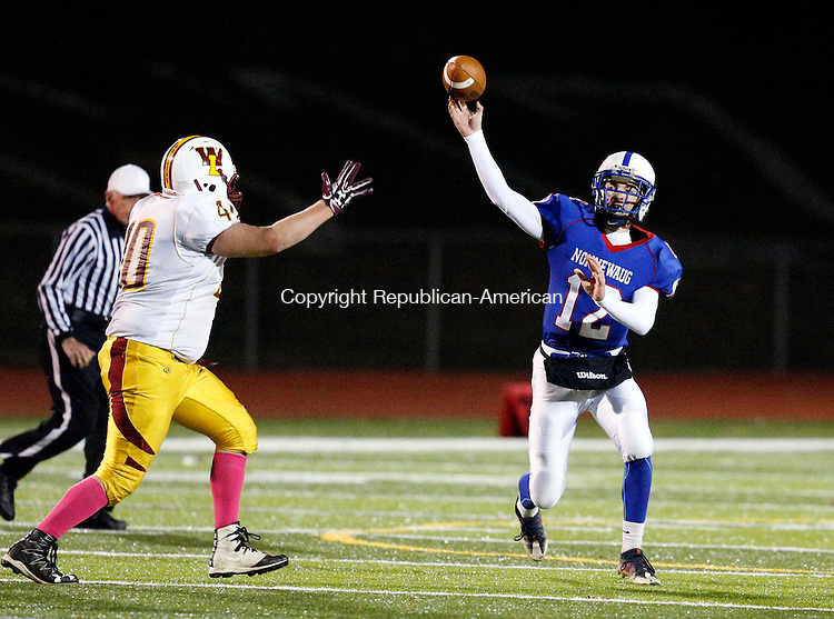 Southbury, CT- 18 November 2016-111816CM05-  Nonnewaug's Jarrett Michaels gets off a pass as he's rushed by Windsor Lock's Brandon Spears during their football matchup in Southbury on Friday.    Christopher Massa Republican-American