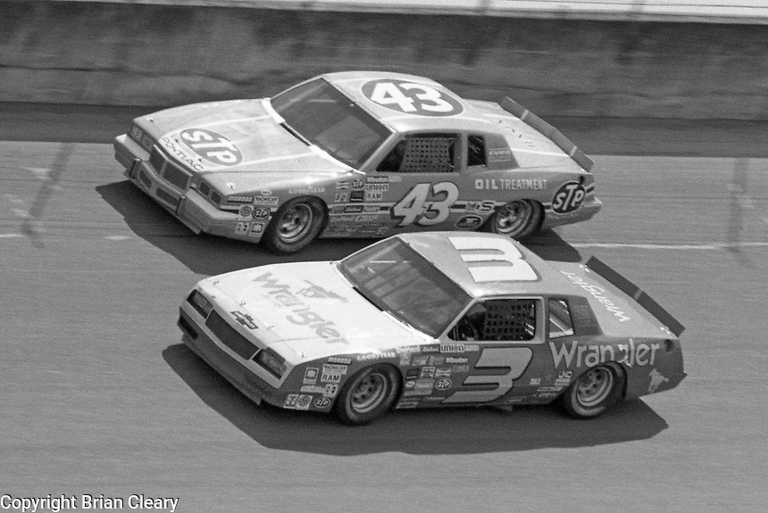 Richard Petty Dale Earnhardt side by side Firecracker 400 at Daytona International Speedway in Daytona beach, FL on July 4m 1984.  (Photo by Brian Cleary/www.bcpix.com)