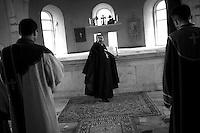"""Nagorny-Karabach, 15.05.2011, Shushi. Ein Priester in einer Lithurgie am Sonntag. """"The Twentieth Spring"""" - ein Portrait der s¸dkaukasischen Stadt Schuschi, 20 Jahre nach der Eroberung der Stadt durch armenische K?mpfer 1992 im B¸gerkrieg um die Unabh?ngigkeit Nagorny-Karabachs (1991-1994).A priest during a liturgy in Karabaghtots church. """"The Twentieth Spring"""" - A portrait of Shushi, a south caucasian town 20 years after its """"Liberation"""" by armenian fighters during the civil war for independence of Nagorny-Karabakh (1991-1994). .Un prêtre au cours d'une liturgie dans l'église Karabaghtots. """"Le Vingtieme Anniversaire"""" - Un portrait de Chouchi, une ville du Caucase du Sud 20 ans après sa «libération» par les combattants arméniens pendant la guerre civile pour l'indépendance du Haut-Karabakh (1991-1994)..© Timo Vogt/Est&Ost, NO MODEL RELEASE !!"""