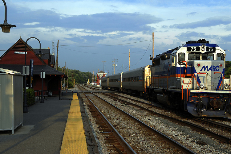MARC Commuter train pulls out of Brunswick station in Brunswick Maryland.