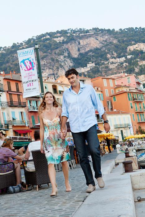 Pierre and Caroline walk along the harbour in Villefranche-sur-Mer, France, 7 September 2012