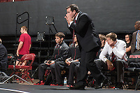 STANFORD, CA - January 18, 2015: Head coach Jason Borrelli of the Stanford Cardinal wrestling team coaches during a meet against Cal Poly at Maples Pavilion. Stanford won 22-13.