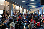 Passengers await a flight to Los Angeles at Gate F8 at the Maynard H. Jackson Jr. International Terminal at Hartsfield–Jackson Atlanta International Airport, in Atlanta, Georgia on August 28, 2013.