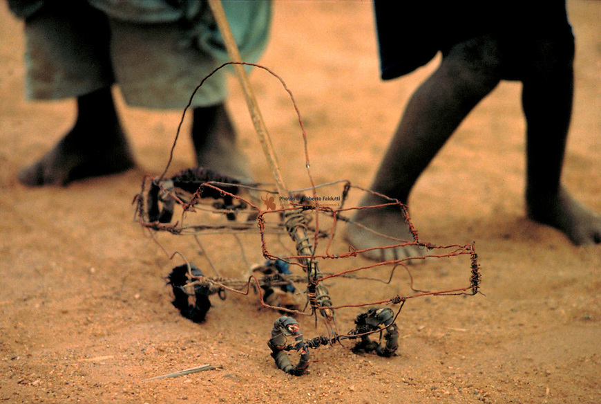 Children playing with a homemade truk toy