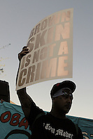 "Phoenix, Arizona. June 25, 2012 - A demonstrator holds a sign that reads ""Brown is not a Crime"" at the protest against the U.S. Supreme Court ruling on SB 1070. Arizona's own immigration policies have resulted in documented cases of racial profile against brown-skinned people. Immigrant rights groups protested the United States Supreme Court ruling on Arizona law for upholding SB 1070's provision that will allow police to demand papers if there's reasonable suspicion that a person may be illegally in the country. Photo by Eduardo Barraza © 2012"