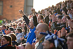 "Portsmouth 1 Southampton 1, 18/12/2012. Fratton Park, Championship. Portsmouth fans in the Fratton End stand at Fratton Park stadium cheering their team on as their club take on local rivals Southampton in a Championship fixture. Around 3000 away fans were taken directly to the game in a fleet of buses in a police operation known as the ""coach bubble"" to avoid the possibility of disorder between rival fans. The match ended in a one-all draw watched by a near capacity crowd of 19,879. Photo by Colin McPherson."