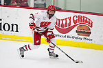 Wisconsin Badgers Kelly Jaminski (7) handles the puck during an NCAA women's college playoff ice hockey game against the St. Cloud State Huskies Saturday, March 2, 2013, in Madison, Wis. The Badgers won 4-1. (Photo by David Stluka)