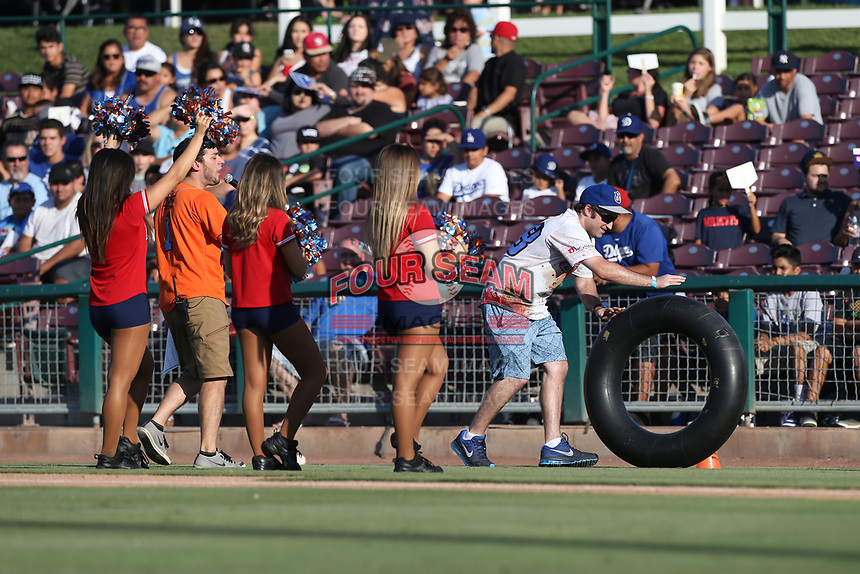 A fan participates in a between innings entertainment event during a game between the the Inland Empire 66ers and the Rancho Cucamonga Quakes at San Manuel Stadium on July 29, 2017 in San Bernardino, California. Inland Empire defeated Rancho Cucamonga, 6-4. (Larry Goren/Four Seam Images)