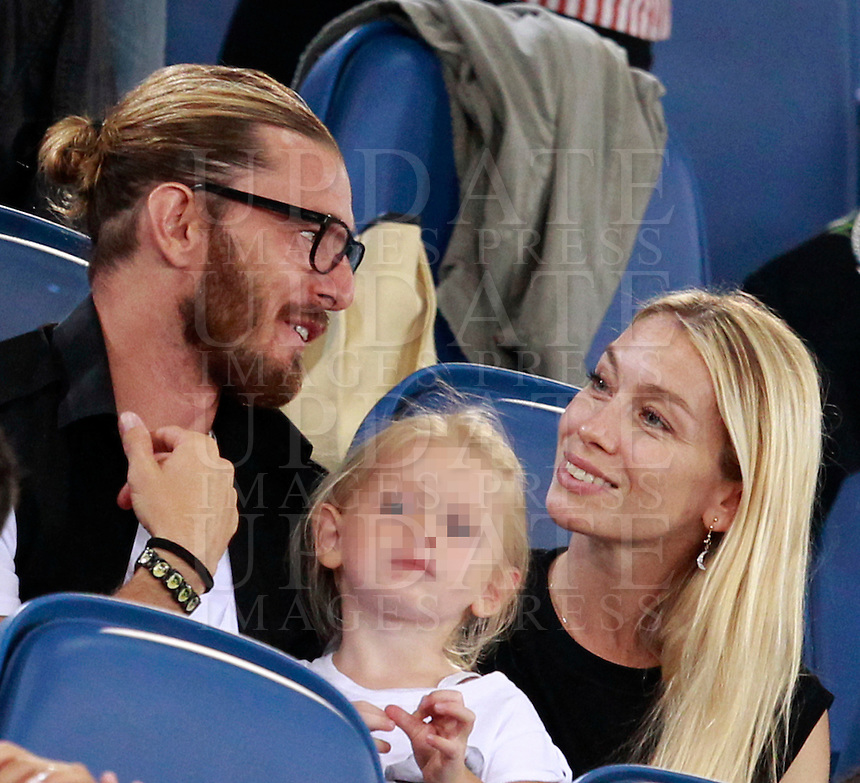 Calcio, amichevole Roma vs Fenerbahce. Roma, stadio Olimpico, 19 agosto 2014.<br /> Roma defender Federico Balzaretti, left, his wife, dancer, actress and model Eleonora Abbagnato, Etoile of the Paris Opera Ballet and their daughter Julia sit on the stand on the occasion the friendly match between AS Roma and Fenerbahce at Rome's Olympic stadium, 19 August 2014.<br /> UPDATE IMAGES PRESS/Isabella Bonotto