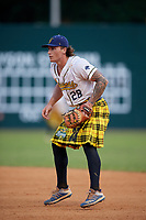 Savannah Bananas first baseman Daniel Oberst (28) during a Coastal Plain League game against the Macon Bacon on July 15, 2020 at Grayson Stadium in Savannah, Georgia.  Savannah wore kilts for their St. Patrick's Day in July promotion.  (Mike Janes/Four Seam Images)