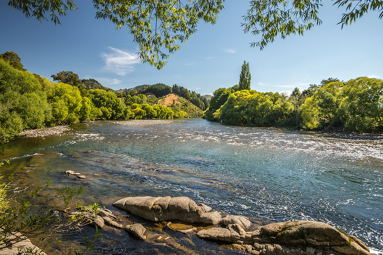 Summer day view of the Motueka River near ngatimoti. New Zealand - stock photo, canvas, fine art print