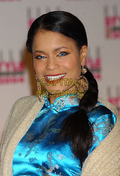 BLU CANTRELL.Elle Style Awards at the Natural History Museum.16 February 2004.headshot, portrait, mandarin collar, make-up, big earrings.www.capitalpictures.com.sales@capitalpictures.com.©Capital Pictures