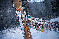 The Razluka Brook. People attach things to the wooden pillar wishing for good luck in continuing their journey along the Kolyma Highway through the Verkhoyansk mountain range, in one of the coldest inhabited areas on earth.