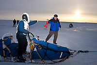 Rookie musher and red lantern award winner Celeste Davis runs up the seawall ramp with her red lantern just a few hundred yards from the finish line in Nome during the 2010 Iditarod