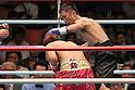 (R-L) Daisuke Naito, Noriyuki Komatsu (JPN), JUNE 27, 2006 - Boxing : Daisuke Naito of Japan in action against Noriyuki Komatsu of Japan during the OPBF and Japanese flyweight titles bout at Korakuen Hall in Tokyo, Japan. (Photo by Hiroaki Yamaguchi/AFLO)