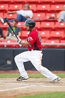 Jared Bolden #15 of the Hickory Crawdads follows through on his swing against the Kannapolis Intimidators at  L.P. Frans Stadium August 1, 2010, in Hickory, North Carolina.  Photo by Brian Westerholt / Four Seam Images