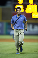 Burlington Royals trainer Saburo Hagihara jogs off the field during the game against the Greeneville Astros at Burlington Athletic Park on August 29, 2015 in Burlington, North Carolina.  The Royals defeated the Astros 3-1. (Brian Westerholt/Four Seam Images)