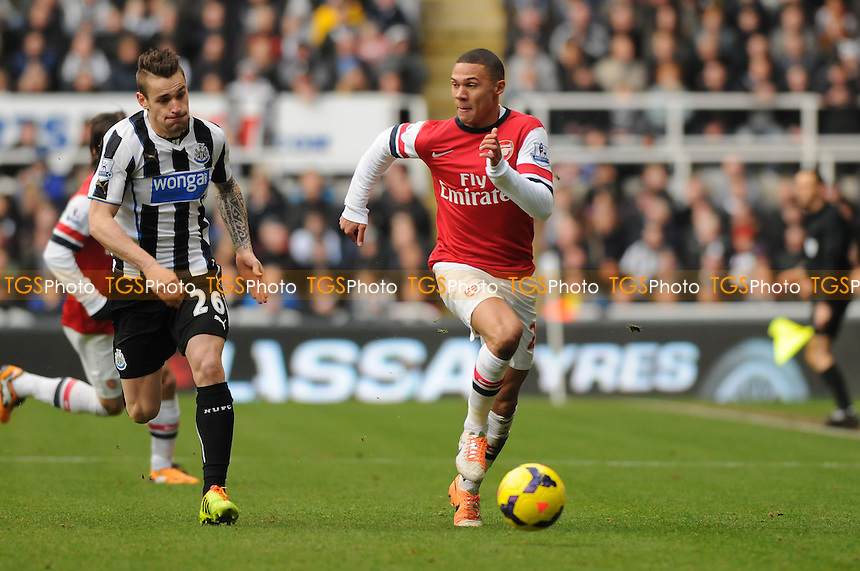 Kieran Gibbs of Arsenal battles with Mathieu Debuchy of Newcastle United - Newcastle United vs Arsenal - Barclays Premier League Football at St James Park, Newcastle upon Tyne - 29/12/13 - MANDATORY CREDIT: Steven White/TGSPHOTO - Self billing applies where appropriate - 0845 094 6026 - contact@tgsphoto.co.uk - NO UNPAID USE
