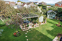 BNPS.co.uk (01202 558833)<br /> Pic: PurpleBricks/BNPS<br /> <br /> Garden. <br /> <br /> This £475,000 seaside cottage contains a charming secret – it's built around two Victorian railway carriages.<br /> <br /> The 19th century carriages were used as temporary housing for soldiers returning from the First World War when there was a shortage of homes.<br /> <br /> But many of them remained in place years later and had bricks and mortar built around them.<br /> <br /> And so from the street view they looked like normal houses but inside the main reception rooms were with the converted carriages.